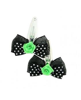 Barrette noire à pois blancs avec une rose verte.