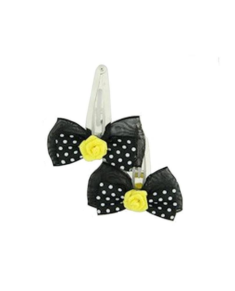 Barrette noire à pois blancs avec une rose jaune.