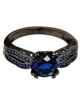 Bague noire avec pierres bleues